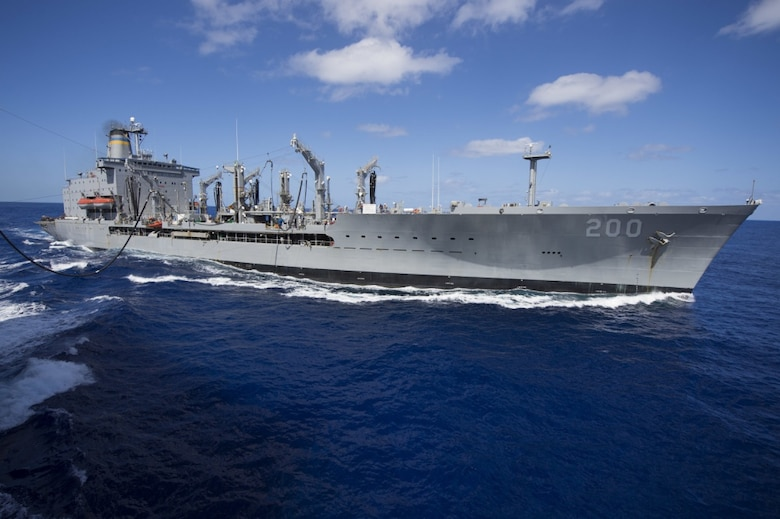 The Military Sealift Command fleet replenishment oiler USNS Guadalupe (T-AO 200) sends fuel to the dock landing ship USS Comstock (LSD 45) during a replenishment at sea. Comstock, part of the Makin Island Amphibious Ready Group, and the embarked 11th Marine Expeditionary Unit are returning to homeport San Diego following a seven-month deployment to the Western Pacific and the U.S. Central Command areas of operation. (U.S. Navy photo by Mass Communication Specialist 3rd Class Lenny LaCrosse/Released)