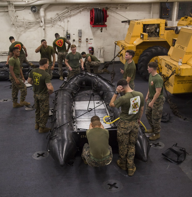 Marines prepare combat rubber reconnaissance crafts (CRRC) for boat raids during Blue Chromite 2017 in Okinawa, Japan, October 29, 2016. Blue Chromite is a large-scale amphibious mission rehearsal which strengthens the Navy-Marine Corps expeditionary, amphibious rapid response capabilities based in Okinawa and the greater Indo-Asia-Pacific region. Pacific region Marines are assigned to 3rd Battalion, 3rd Marine Regiment which is forward deployed from Kaneohe Bay, Hawaii, to 3rd Marine Division, based in Okinawa, Japan. (U.S. Marine Corps photo by Lance Cpl. Jesus McCloud)