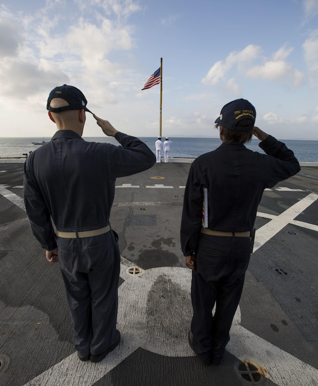 U.S Navy Sailors aboard the amphibious transportation dock ship USS Green Bay (LPD 20) salute the flag as it is raised for colors during Blue Chromite 2017 in Okinawa, Japan, October 29, 2016. Blue Chromite is a U.S. –only exercise which strengthens the Navy-Marine Corps expeditionary, amphibious rapid-response capabilities based in Okinawa and the greater Indo-Asia-Pacific region. (U.S. Marine Corps photo by Lance Cpl. Jesus McCloud)