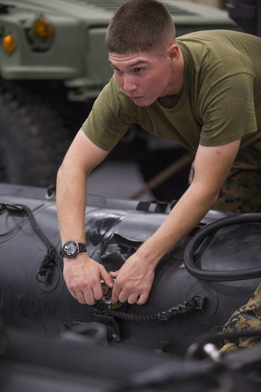 Pfc. Remington J. Heishman prepares a combat rubber reconnaissance crafts (CRRC) for a boat raid during Blue Chromite 2017 in Okinawa, Japan, October 29, 2016. Blue Chromite is a U.S. –only exercise which strengthens the Navy-Marine Corps expeditionary, amphibious rapid-response capabilities based in Okinawa and the greater Indo-Asia-Pacific region. Heishman is a rifleman assigned to 3rd Battalion, 3rd Marine Regiment which is forward deployed from Kaneohe Bay, Hawaii, to 3rd Marine Division, based in Okinawa, Japan (U.S. Marine Corps photo by Lance Cpl. Jesus McCloud)