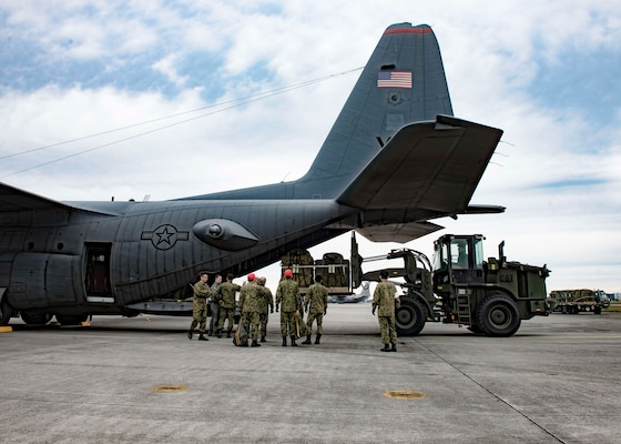 Japan Ground Self-Defense Force and 36th Airlift Squadron members load container delivery system bundles onto a C-130 Hercules during Keen Sword 2017, Nov. 10, 2016, at Yokota Air Base, Japan. Keen Sword is the largest joint, bilateral field training exercise between the U.S. military and the Japan Self-Defense Force. (U.S. Air Force photo by Airman 1st Class Donald Hudson/Released)
