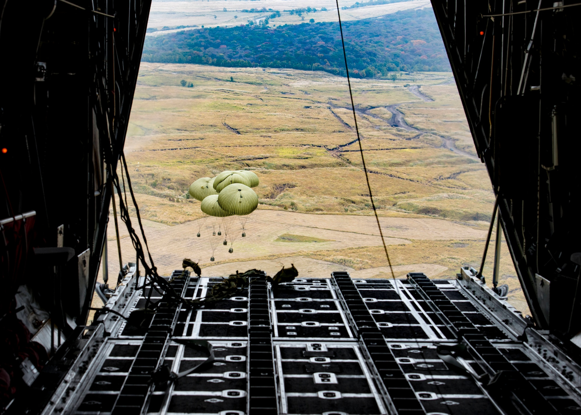 Japan Ground Self-Defense Force container delivery system bundles parachute to a drop zone after being dropped out of a C-130 Hercules during Keen Sword 2017, Nov. 10, 2016, over the Kyushu prefecture, Japan. Keen Sword is designed to practice the critical capabilities to support the defense of Japan, and to respond to a potential crisis or contingency in the Indo-Asia-Pacific region. (U.S. Air Force photo by Airman 1st Class Donald Hudson/Released)