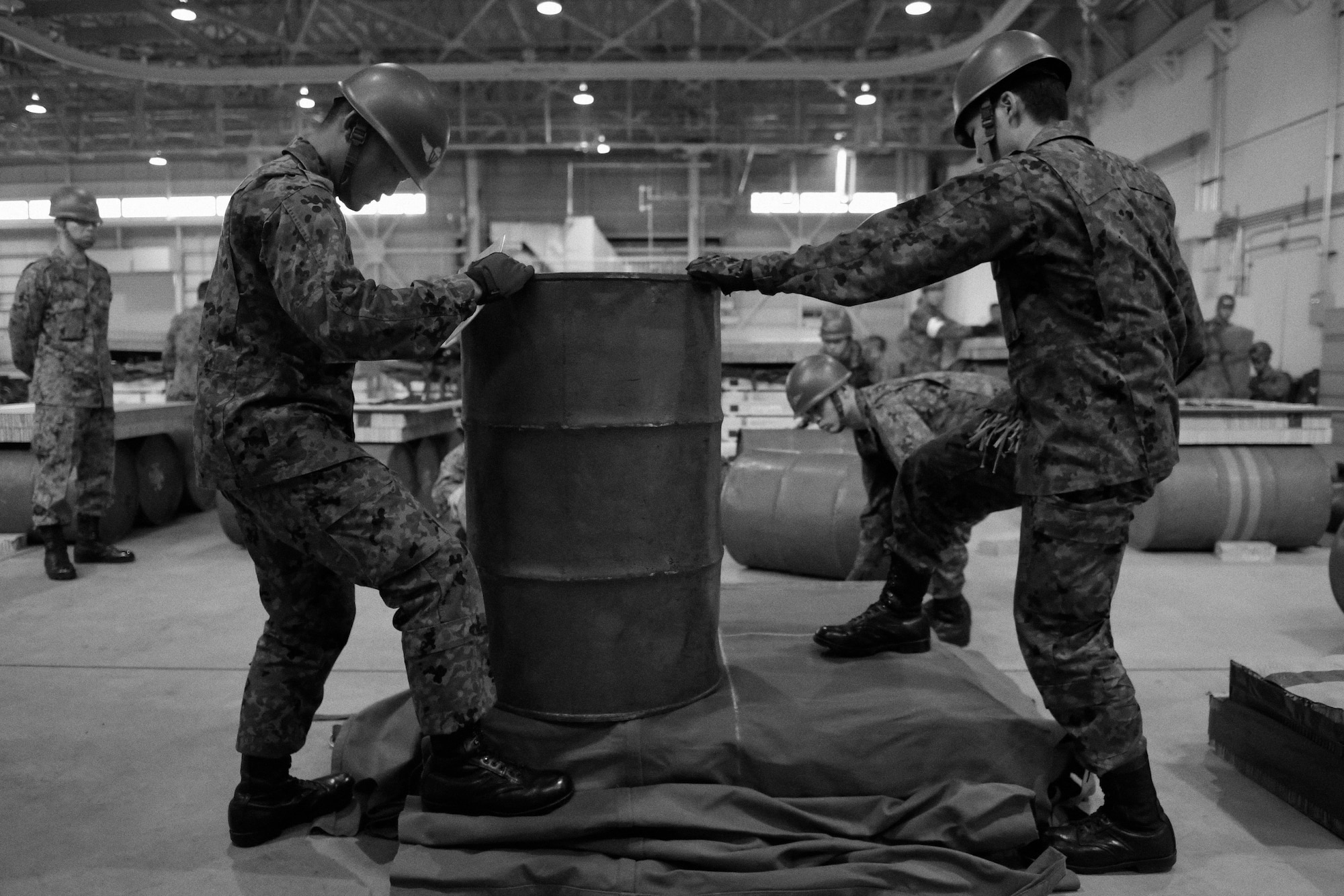Japan Ground Self-Defense Force members prepare to construct a container delivery system bundle at Yokota Air Base, Japan, Nov. 7, 2016. As part of Keen Sword 17, U.S. and Japan Self-Defense Force members participated in C-17 Globemaster III tie-down training, UH-1N Iroquois night flight familiarization and C-130 Hercules container delivery system bundle drops, each designed to increase combat readiness and interoperability within the framework of the U.S.-Japan alliance. (U.S. Air Force photo by Senior Airman Delano Scott/Released)