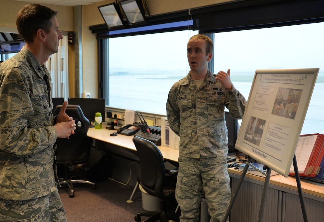 U.S. Air Force Col. Bradley Spears, left, 521st Air Mobility Operations Wing vice commander, speaks to U.S. Air Force Staff Sgt. Daniel Kraus, 727th Air Mobility Squadron information controller, during a tour Nov. 9, 2016, on RAF Mildenhall, England. The leader hoped to gain inside knowledge into Airmen's needs to carry out the mission, and what leadership could do to assist. (U.S. Air Force photo by Gina Randall)