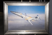 """DAYTON, Ohio - A giclee of """"Schrek's CIN MIN on the SUN-RUN"""" by aviation artist William S. Phillips in the Southeast Asia War Gallery at the National Museum of the U.S. Air Force. (U.S. Air Force photo)"""
