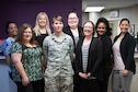 Staff Sgt. Lacey Matthews, 403rd Aircraft Maintainance Squadron crew chief, presents a donation to the Gulf Coast Women's Center for Nonviolence. 403rd Wing members raised more than $1,300 as part of their support of the Green Dot program, which is the U.S. Air Force's program to help raise awareness of and prevent sexual assault, domestic violence and stalking.(U.S. Air Force photo/Staff Sgt. Heather Heiney)