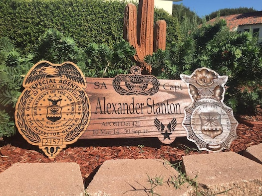 Special Agent (Capt.) Justin Soderlund crafted this woodcarving memorial to Special Agent (Capt.) Alexander Stanton of Det. 421, Luke Air Force Base, Ariz., who died in a motorcycle accident Sept. 30, 2016, near his home in Scottsdale, Ariz. (U.S. Air Force photo courtesy SA Justin Soderlund)