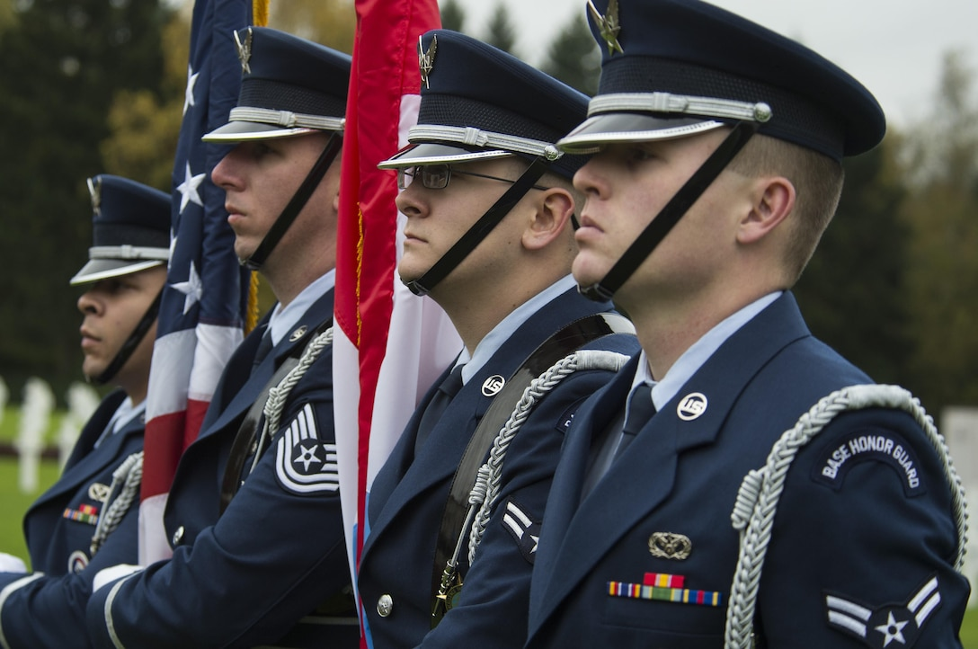 U.S. Air Force Ceremonial Guardsmen stand at attention during a Veterans Day ceremony at the Luxembourg American Cemetery and Memorial in Hamm, Luxembourg City, Luxembourg, Nov. 11, 2016. The American Battle Monuments Commission administers the cemetery which serves as the final resting places of 5,076 American service members. (U.S. Air Force photo by Senior Airman Dawn M. Weber)