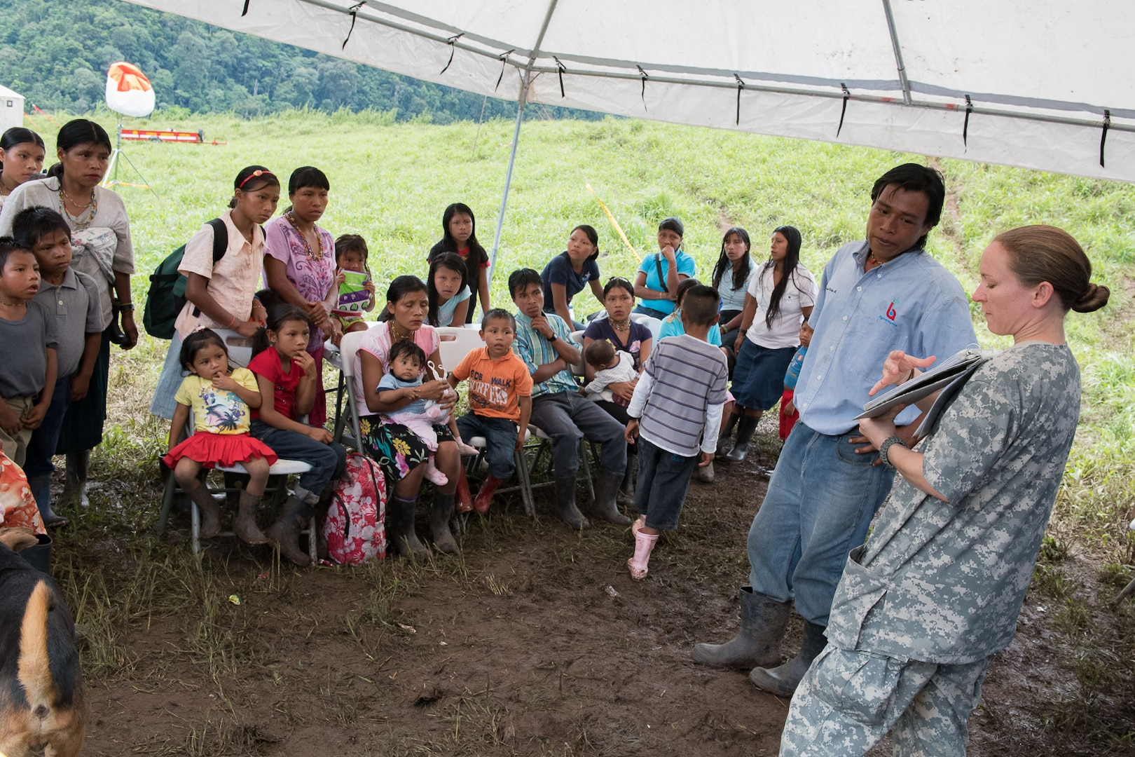Army Staff Sgt. Lisa Kent, Joint Task Force-Bravo preventive medicine technician, instructs a family on preventive health practices during Operation Pura Vida, a joint humanitarian mission and Medical Readiness Training Exercise at an indigenous region in the Caribbean province of Limón, Nov. 1 to 3. The group arrived in four helicopters from the 1st Battalion 228th Aviation Regiment and joined 30 Costa Rican physicians to provide basic healthcare services to approximately 300 residents of the indigenous village of Piedra Mesa, Telire region of Talamanca, Limón