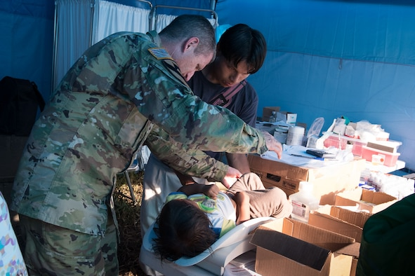Colonel Douglas Lougee, Medical Element commander and pediatrician, weighs a child during Operation Pura Vida, a joint humanitarian mission and Medical Readiness Training Exercise at an indigenous region in the Caribbean province of Limón, Nov. 2. A Group of 16 JTF-Bravo medical professionals arrived in four helicopters from the 1st Battalion 228th Aviation Regiment and joined 30 Costa Rican physicians to provide basic healthcare services to approximately 300 residents of the indigenous village of Piedra Mesa, Telire region of Talamanca, Limón.