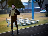 U.S. Air Force Airman 1st Class Haden Pyatt, 27th Special Operations Civil Engineer Squadron Explosive Ordnance Disposal  technincian, completes a 400-meter run during the 3rd annual EOD 132 workout Nov. 10, 2016, at Cannon Air Force Base, N.M.. This annual workout is in honor of the 132 EOD technicians who have passed away since the 9/11 tragedy. (U.S. Air Force photo by Staff Sgt. Eboni Reams/Released)