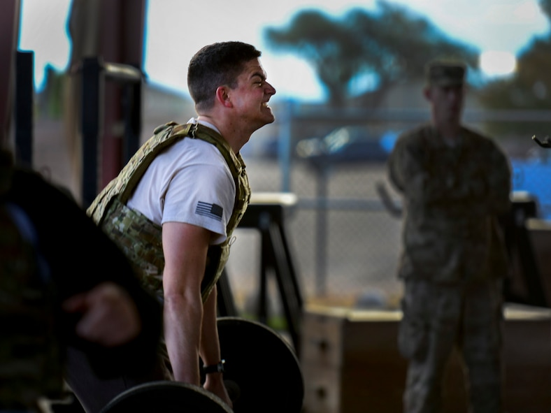U.S. Air Force Senior Airman Ryan Thomas, 27th Special Operations Civil Engineer Squadron Explosive Ordnance Disposal  technincian, performs hand cleans during the 3rd annual EOD 132 workout Nov. 10, 2016, at Cannon Air Force Base, N.M.. This annual workout is in honor of the 132 EOD technicians who have passed away since the 9/11 tragedy. (U.S. Air Force photo by Staff Sgt. Eboni Reams/Released)