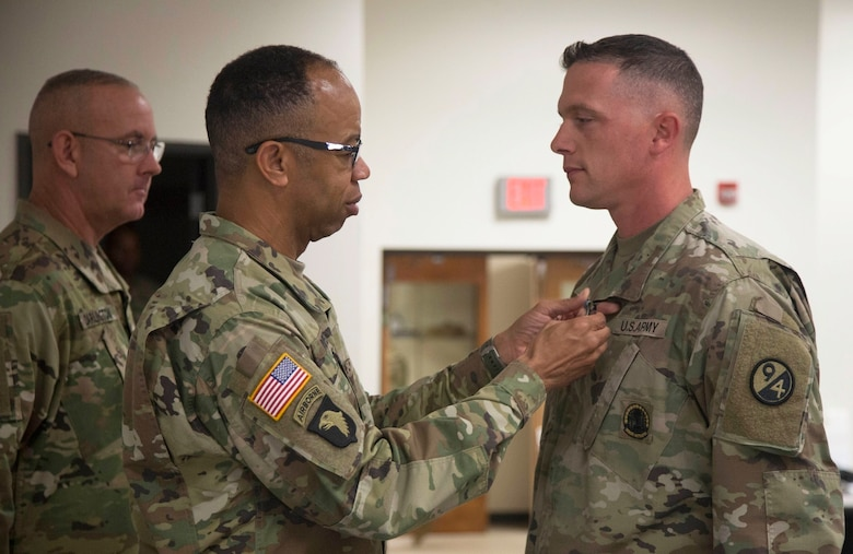 80th Training Command Commander Maj. Gen. A.C. Roper pins the Army Achievement Medal on Sgt. 1st Class Kevin Hiles for earning the NCO Instructor of the Year at the 80th's 2016 IOY competition at Fort Knox, Ky., Oct. 23, 2016. Photo taken by Spc. Sarah Ruiz, 55th Signal Company (Combat Camera).