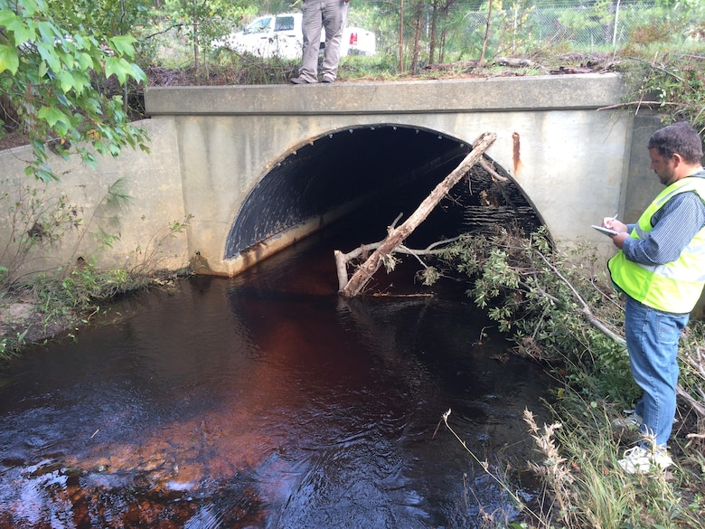 Patrick Hager, a Savannah District structural engineer, inspects an impacted culvert on Fort Bragg in North Carolina Oct. 14, 2016. The structure located downstream of a water crossing, was inaccessible due to fencing barriers and partial overtopping from debris.