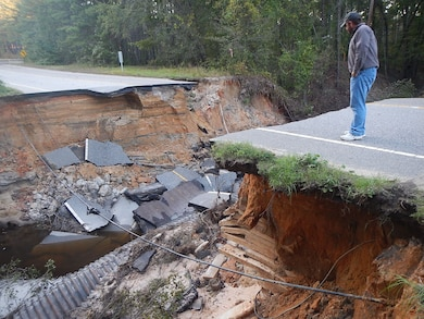 Patrick Hager, a Savannah District structural engineer, inspects a water crossing that failed due to flooding on Fort Bragg in North Carolina Oct. 13, 2016.