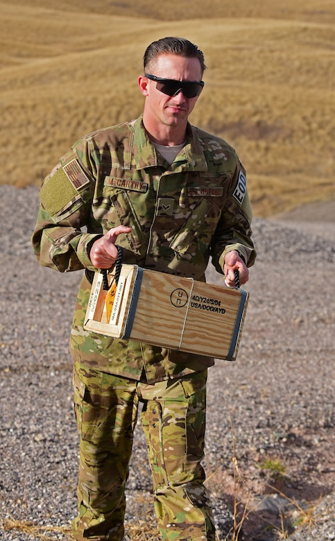 Senior Airman Zachary McCarthy, explosive ordnance disposal apprentice assigned to the 28th Civil Engineer Squadron, carries a box of explosives at Ellsworth Air Force Base S.D., Nov. 14, 2016. The box contains a plastic explosive used to detonate unexploded ordinance. (U.S. Air Force photo by Airman 1st Class James L. Miller)