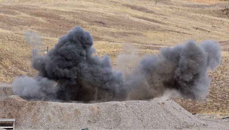 A controlled explosive ordnance disposal creates a cloud of smoke at Ellsworth Air Force Base, S.D., Nov. 14, 2016. The explosion was part of a display to demonstrate the capabilities of EOD Airmen. (U.S. Air Force photo by Airman 1st Class James L. Miller)
