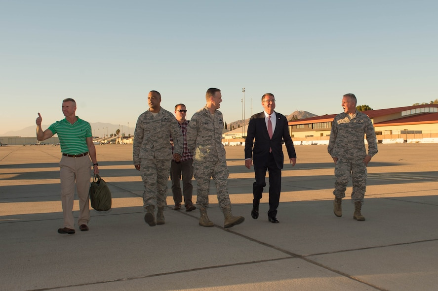 Defense Secretary Ash Carter, second from right, walks with senior leaders after arriving at March Air Reserve Base near Riverside, Calif.