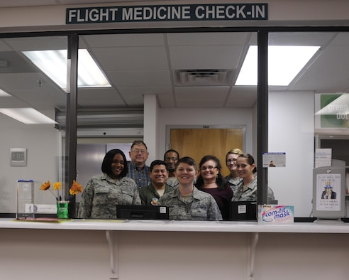 Members of the 325th Aerospace Medicine Squadron flight medicine section gather for a photo Oct. 25, 2016. The flight medicine section is divided into two sections: the base operational medicine clinic, which focuses on the administrative aspect of medical needs, and the flight operational clinic, which focuses on the physical examinations. Both sections work in tandem to ensure the medical deployment readiness of Tyndall Airmen. (U.S. Air Force photo by Senior Airman Solomon Cook/Released)