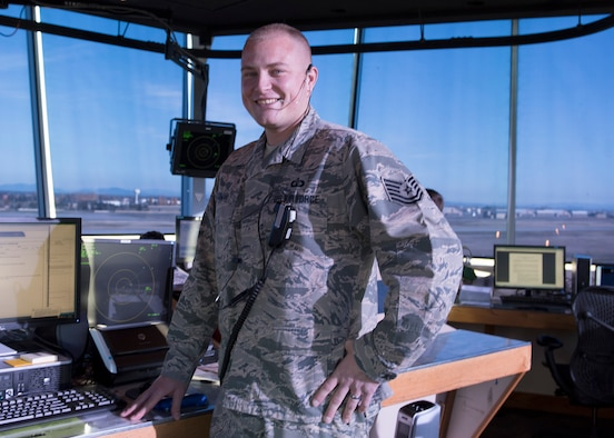 Tech. Sgt. Adam J. Blizman, 92nd Operations Support Squadron Air Traffic Control Tower watch supervisor, stands in front of a doppler radar station in the air traffic control tower Nov 10, 2016, at Fairchild Air Force Base. Showing outstanding leadership led to his selection as one of Fairchild's Finest, a weekly recognition program that highlights top-performing Airmen. (U.S. Air Force photo/Airman 1st Class Ryan Lackey)