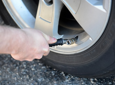 Before long travel, check tire pressure in all tires, including spare tires, and fill them to the recommended level on the vehicle's tire information placard, certification label, or in the owner's manual. Don't rush when traveling and remain vigilant as tires can lose air suddenly if you drive over a pothole, other object or if you strike the curb when parking. (U.S. Air Force photo by Staff Sgt. Teresa J. Cleveland)