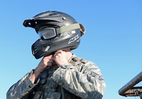 Tech. Sgt. Jeremy Delvaux, 9th Security Forces Squadron flight chief, dons a helmet for a coyote patrol Nov. 4, 2016, at Beale Air Force Base, California. Security forces' personnel wear safety equipment and receive training to ensure their safety on patrols. (U.S. Air Force photo/Airman Tristan D. Viglianco)