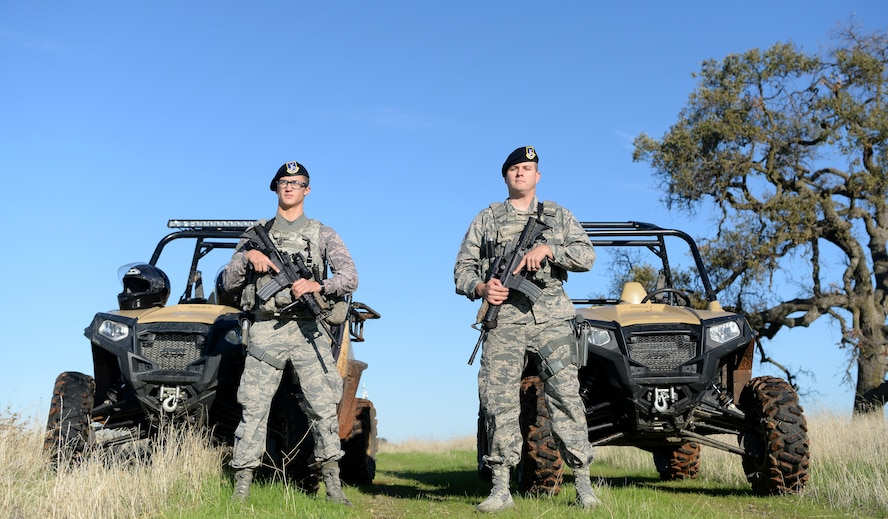 Airman 1st Class Luis Valentin, 9th Security Forces Squadron installation entry controller, and Senior Airman David Gill, 9th SFS base defense operation controller pause during a coyote run Nov. 4, 2016, at Beale Air Force Base, California. Security forces' personnel patrol the perimeter of the base at least once per shift. (U.S. Air Force photo/Airman Tristan D. Viglianco)