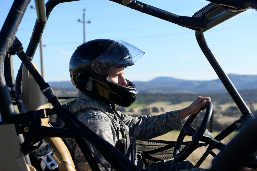 Senior Airman David Gill, 9th Security Forces Squadron base defense operation controller, drives an all-terrain vehicle on the outskirts of Beale Air Force Base, California, Nov. 4, 2016. On the patrols personnel check for intruders and damage to the installation perimeter. (U.S. Air Force photo/Airman Tristan D. Viglianco)