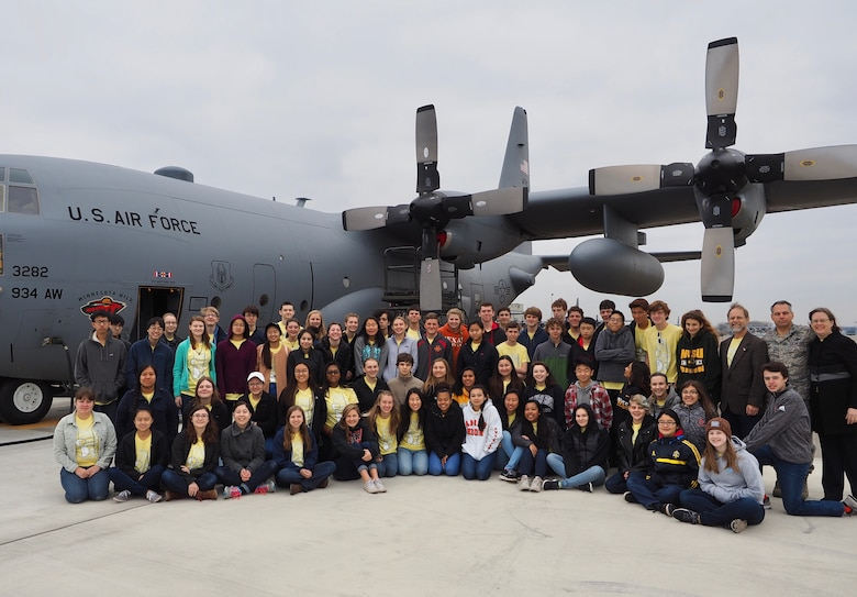 Members of the Ames High School orchestra pose next to a 934th Airlift Wing C-130 after a tour of the aircraft Nov. 14.