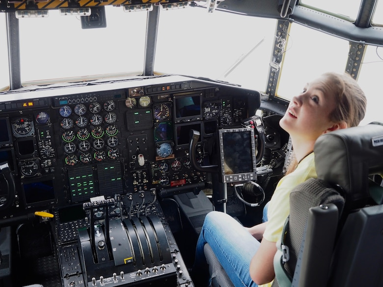 A member of the Ames High School orchestra from Ames, Iowa, gets a close up look at cockpit inside a 934th Airlift Wing C-130.