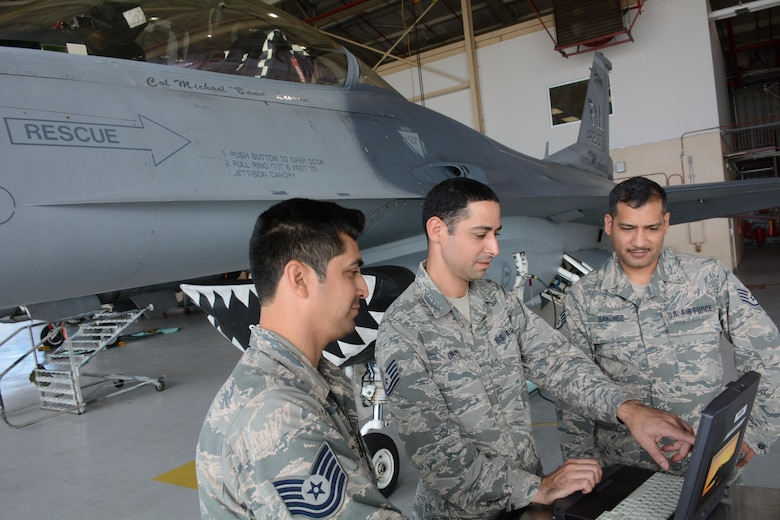 Airmen from the 482nd Fighter Wing examine ways to prevent malware from coming onto aircraft at Homestead Air Reserve Base, Fla., Nov. 15, 2016. The 482nd Communications Squadron ext pathfinder units are looking at ways to integrate defensive cyber operations concepts into their Wings' core mission. (U.S. Air Force photo by Desiree W. Moye )