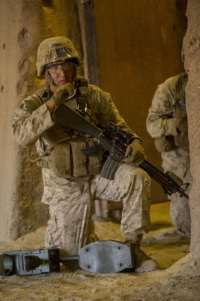 A Marine with 3rd Battalion, 5th Marines, 1st Marine Division, spots a potential improvised explosive device during an immediate action demonstration for members of the Marines' Memorial Association aboard Marine Corps Base Camp Pendleton, Calif., Sep. 19, 2016. The Marines were placed in an IED scenario inside of the Infantry Immersion Trainer, a training complex that creates real-life scenarios for Marines to demonstrate and hone their military skills. (U.S. Marine Corps photo by Lance Cpl. Bradley J. Morrow)