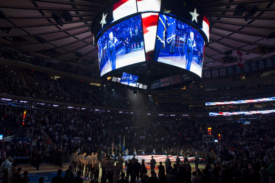 Members of the U.S. Air Force Honor Guard Drill Team present colors and hold the American flag during the National Anthem before the New York Knicks game at Madison Square Garden in New York, Nov. 9, 2016. The drill team was later featured during halftime as part of a Knicks military appreciation night. (U.S. Air Force photo by Senior Airman Philip Bryant)