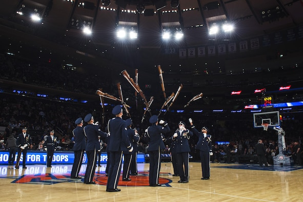 Members of the U.S. Air Force Honor Guard Drill Team perform a 12-man routine during halftime of the New York Knicks game at Madison Square Garden in New York, Nov. 9, 2016. The drill team showcased their skills in precision and weapon maneuvers in front of more than 19,000 people in the historic Madison Square Garden. (U.S. Air Force photo by Senior Airman Philip Bryant)