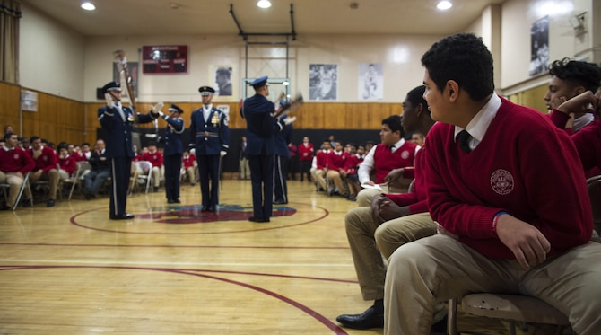 Members of the U.S. Air Force Honor Guard Drill Team perform a four-man routine in front of La Salle Academy students during a school visit in New York, Nov. 10, 2016. The drill team was one of many military performances and speakers during the La Salle Academy military day to educate students about the different branches of service. (U.S. Air Force photo by Senior Airman Philip Bryant)