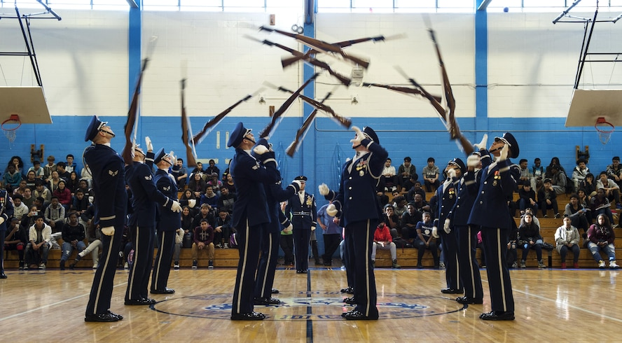 Members of the U.S. Air Force Honor Guard Drill Team perform a 12-man routine in front of Bowne High School students during a school visit in New York, Nov. 10, 2016. The Honor Guard took time to visit two high schools while in New York for America's Parade for Veterans Day. (U.S. Air Force photo by Senior Airman Philip Bryant)