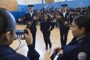 Air Force Junior ROTC students from Bowne High School take photos with U.S. Air Force Honor Guard Drill Team members students during a school visit in New York, Nov. 10, 2016. The drill team had the chance to take photos, answer questions and interact with some of the high school's junior ROTC students. (U.S. Air Force photo by Senior Airman Philip Bryant)