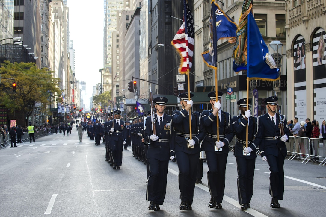 U.S. Air Force Honor Guard marches in the 2016 America's Parade on Veterans Day down Fifth Avenue in Manhattan New York, Nov. 11, 2016. The parade features more than 250 groups and 20,000 participants, including veterans of all eras, military units, junior ROTC's, vintage military vehicles and floats. (U.S. Air Force photo by Senior Airman Philip Bryant)