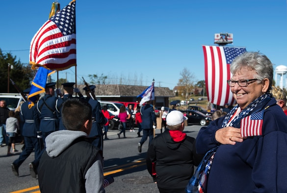 A parade viewer smiles while the U.S. Air Force Honor Guard march in the 4th Annual Veterans Day Parade in Laurel, Del., Nov. 12, 2016. The parade included veterans from other eras, members of the Delaware Army National Guard, and vintage military vehicles. (U.S. Air Force photo by Senior Airman Philip Bryant)