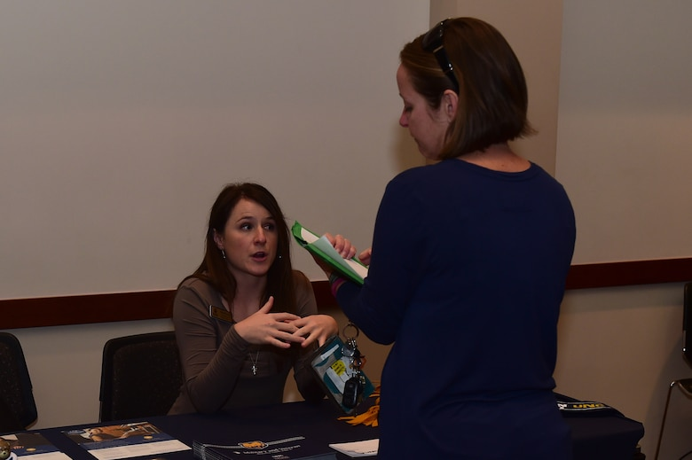 Kara Murray, University of Northern Colorado extended campus enrollment coach and university recruiter, discusses available opportunities with a Team Buckley member Nov. 15, 2016, during an education fair at the Leadership Development Center on Buckley Air Force Base, Colo. Along with the fair, the 460th Space Wing Education Office planned an education open house on Nov. 16 and a CLEP-a-thon on Nov. 17. (U.S. Air Force photo by Airman 1st Class Gabrielle Spradling/Released)