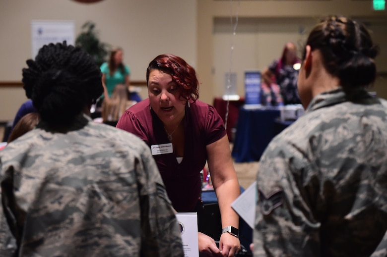 Rica Morales, Colorado Technical University senior admissions advisor, discusses education plans with a Team Buckley members Nov. 15, 2016, during an education fair at the Leadership Development Center on Buckley Air Force Base, Colo. The fair had more than 20 schools available to help guide military members in their educational plans and provided information regarding institution benefits for service members. (U.S. Air Force photo by Airman 1st Class Gabrielle Spradling/Released)