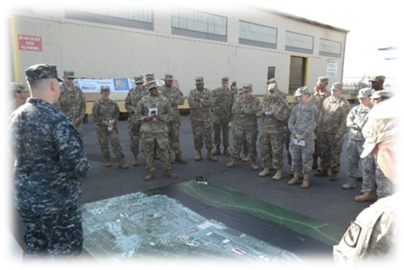 Lt. Col. Dennis Major, 841st Transportation Battalion commanding officer, briefs members of the 525th Military Intelligence Brigade on the capabilities of the Port of Wilmington, N.C. during a tactical exercise held Nov. 2, 2016 at Joint Base Charleston, S.C. Ninety company grade officers and NCO's traveled from Ft. Bragg, N.C. to participate in the exercise.