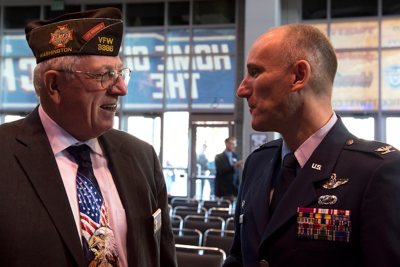 Col. Ryan Samuelson, 92nd Air Refueling Wing commander, speaks with Jerry Herker, Veterans of Foreign Wars Post 51 commander, during a Veterans Day ceremony Nov. 11, 2016, at the Spokane Arena. Samuelson spoke with local veterans and surviving family members of soldiers killed in the line of duty. (U.S. Air Force photo/Airman 1st Class Ryan Lackey)