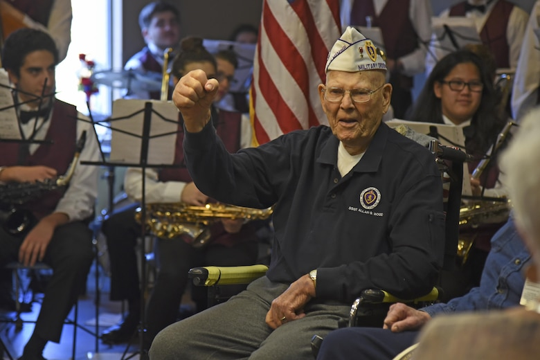 Retired Staff Sgt. Allen G. Wood, United States Army, celebrates during a Veterans Day celebration Nov. 12, 2016, at the Spokane Veterans Home. Wood was honored by the Combat Veterans Motorcycle Association for his years of service in the U.S. Army with the presentation of a handmade shadow box displaying medals received during the time of his service. (U.S. Air Force photo/Senior Airman Mackenzie Richardson)