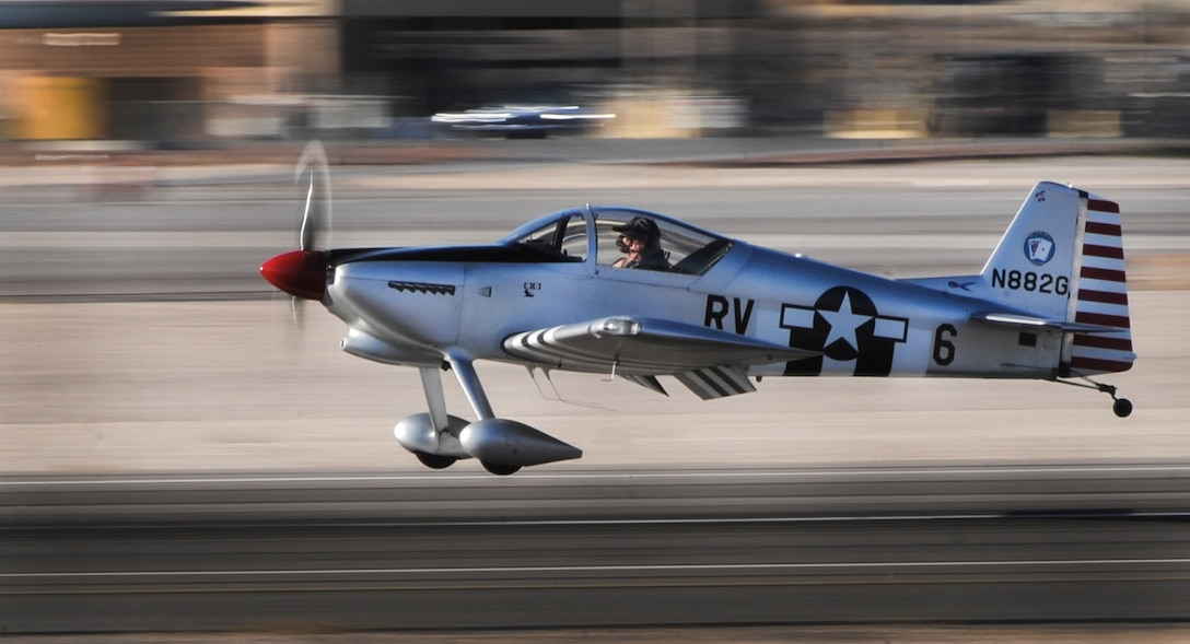 An RV-6 lands after an aerial demonstration during the Aviation Nation air show on Nellis Air Force Base, Nev., Nov. 11, 2016. The aircraft was one of more than 60 acts and static displays showcased during the two-day event. More than 300,000 spectators came from around the world to watch the performances. (U.S. Air Force photo by Airman 1st Class Kevin Tanenbaum/Released)