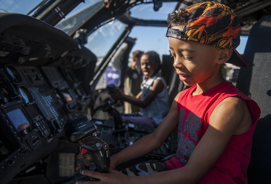 Children play with controls inside of an HH-60G Pave Hawk during the Aviation Nation air show on Nellis Air Force Base, Nev., Nov. 11, 2016. The primary mission of the HH-60G Pave Hawk helicopter is to conduct day or night personnel recovery operations into hostile environments to recover isolated personnel during war. The HH-60G is also tasked to perform military operations other than war, including civil search and rescue, medical evacuation, disaster response, humanitarian assistance, security cooperation/aviation advisory, NASA space flight support, and rescue command and control. (U.S. Air Force photo by Airman 1st Class Kevin Tanenbaum/Released)