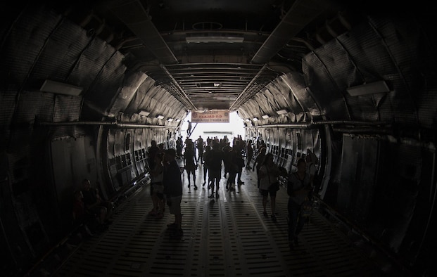 Guests of the Aviation Nation air show walk through a C-5 Galaxy during the Aviation Nation air show on Nellis Air Force Base., Nov. 12, 2016. The C-5 can carry a fully equipped combat-ready military unit to any point in the world on short notice and then provide the supplies required to help sustain the fighting force. (U.S. Air Force photo by Airman 1st Class Kevin Tanenbaum/Released)