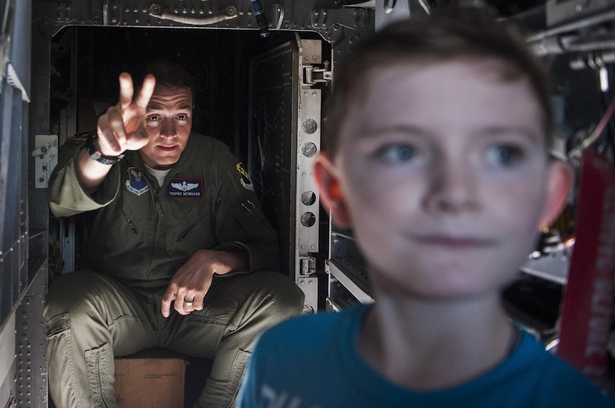 Maj. J. A. Meinhard, 7th Operations Group assistant director of operations, Dyess Air Force Base, Texas, shows a boy around the inside of a B-1 Lancer on Nellis AFB, Nev., Nov. 12, 2016. The multi-mission B-1 is the backbone of America's long-range bomber force. It can rapidly deliver massive quantities of precision and non-precision weapons against any adversary, anywhere in the world, at any time. (U.S. Air Force photo by Airman 1st Class Kevin Tanenbaum/Released)