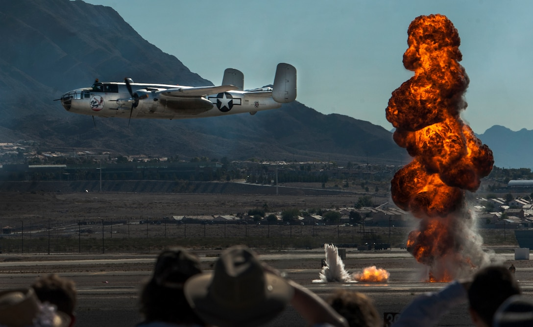 An aircraft flies in front of the crowd during an air-to-ground demonstration at the Aviation Nation air show on Nellis Air Force Base, Nev., Nov. 13, 2016. The many aerial acts and static aircraft displayed during the Nellis Air Show are snapshots of 75 years of aviation history. (U.S. Air Force photo by Airman 1st Class Kevin Tanenbaum/Released)