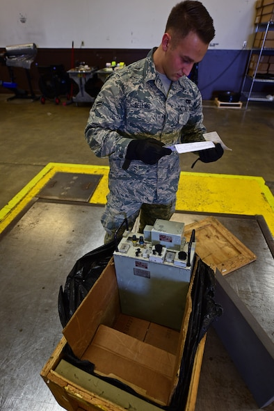 Airman 1st Class James Dellies, a traffic management journeyman assigned to the 28th Logistics Readiness Squadron, checks the packing instructions for a radio transmitter at Ellsworth Air Force Base, S.D., Nov. 8, 2016. The Traffic Management Office is responsible for the entire process of shipping, from packing to labeling. (U.S. Air Force photo by Airman 1st Class James L. Miller)